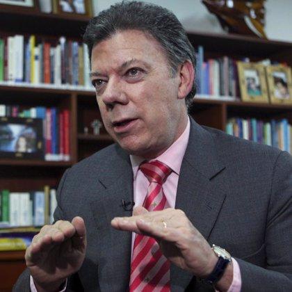 Santos afirma que si gana le dará a Uribe un puesto dentro de su Gobierno