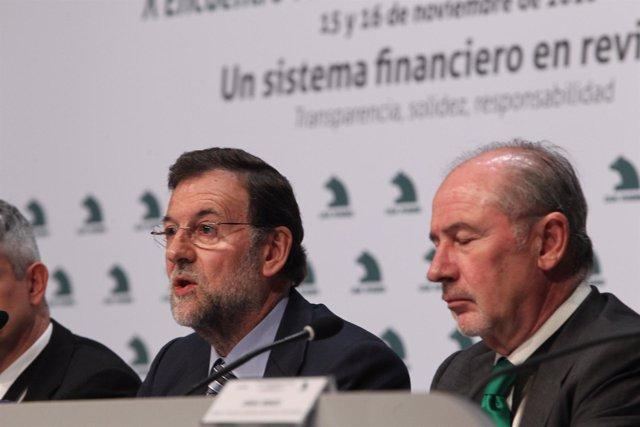Líder del PP, Mariano Rajoy, junto al presidente de Caja Madrid, Rodrigo Rato