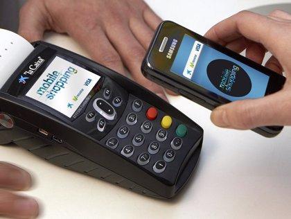 Economía/Telecos.- La Caixa, Telefónica y Visa prevén que el pago por móvil se generalice en España en tres o cinco años