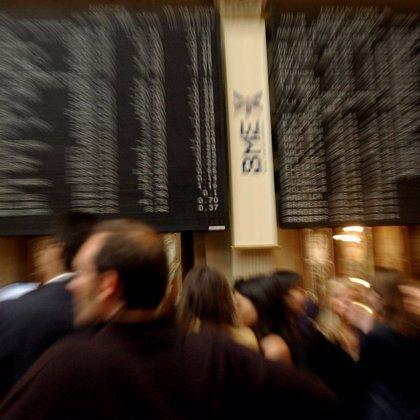 Economía/Bolsa.- Las cotizadas repartieron 21.104 millones de euros en dividendos hasta noviembre, un 28% menos