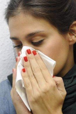Chica con gripe
