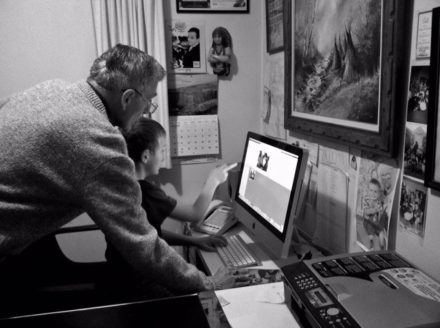 Evan teaches his Grandpa how to do page layout in Pages.