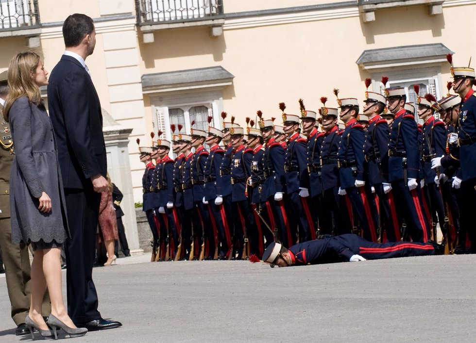Prince Felipe and Princess Letizia of Spain look on after a guard collapsed at t