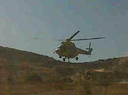 Un Helicóptero De Las Brigadas Forestales De La Comunidad De Madrid