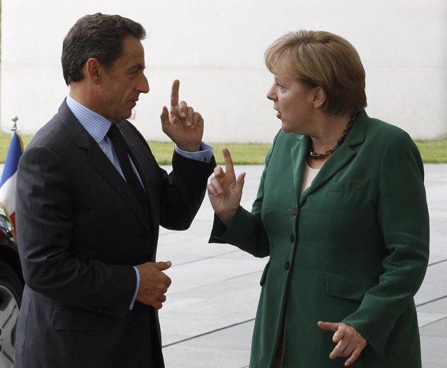 Merkel Y Sarkozy Hablando