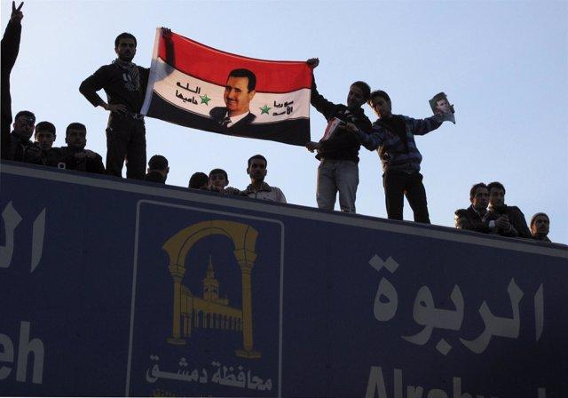 Partidarios Del Presidente Sirio Al Assad