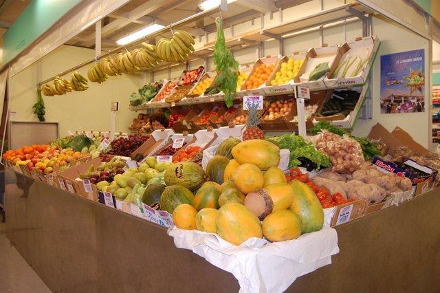 Un Puesto De Fruta En Un Mercado