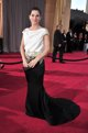 Sandra Bullock posando sobre la alfombra roja de l