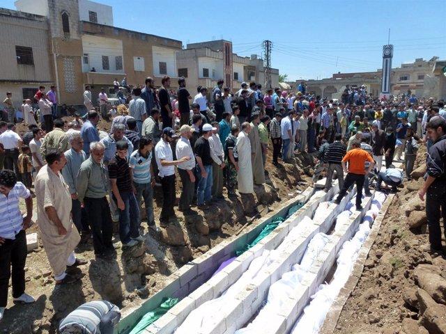 Victimas Del Bombardeo Sobre La Localidad De Hula En Siria