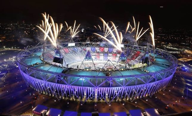 Fireworks explode over the Olympic Stadium during the opening ceremony of the Lo