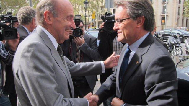 El pte de la Generalitat, A.Mas, y el político M.Roca