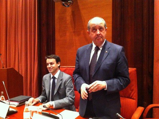 Manel Prat y Felip Puig en el Parlament
