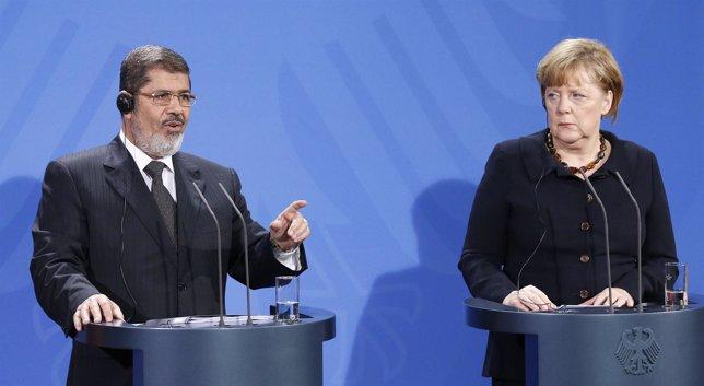 Mohamed Mursi y Angela Merkel