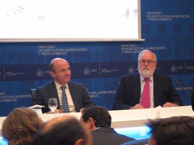 Luis de Guindos y Miguel Arias Cañete