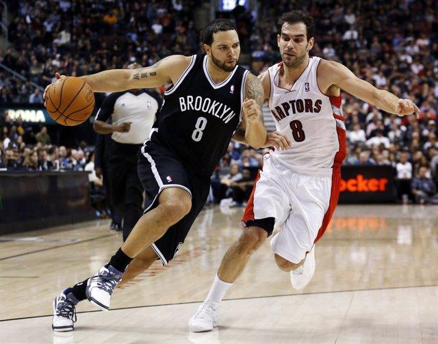 Deron Williams (Brooklyn Nets) y José Manuel Calderón (Toronto Raptors)