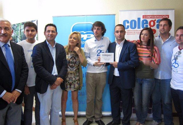 Concejales del PP de Málaga con miembros de Colegas