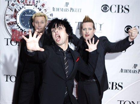 Los miembros de la banda Green Day en un photocall