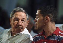 Cuba's President Raul Castro looks at Cuban shipwreck survivor Elian Gonzalez as