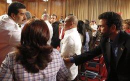 El presidente de Venezuela, Nicolás Maduro, y el opositor Henrique Capriles