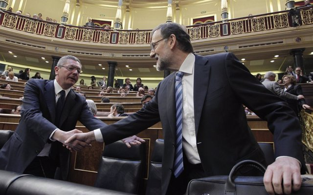 Alberto Ruiz Gallardón y Mariano Rajoy, en el hemiciclo