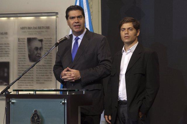 El jefe de Gabinete del Gobierno de Argentina, Jorge Capitanich (izda).