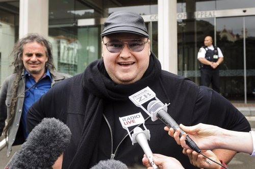 Megaupload founder Dotcom talks to members of the media outside the New Zealand