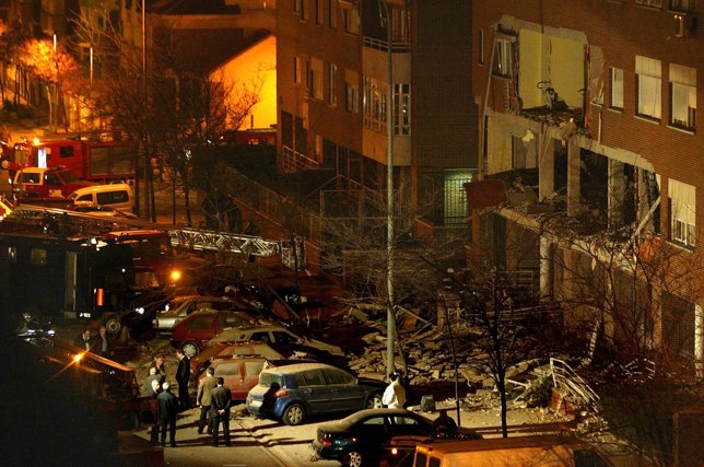 POLICE AND RESCUE WORKERS INSPECT THE SCENE OF AN EXPLOSION NEAR MADRID.