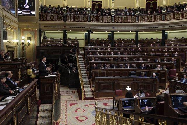 Diputados escuchando a Mariano Rajoy en el hemiciclo