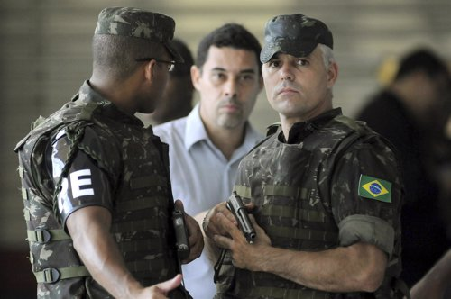 Army officers patrol a shopping center during a police strike in Salvador