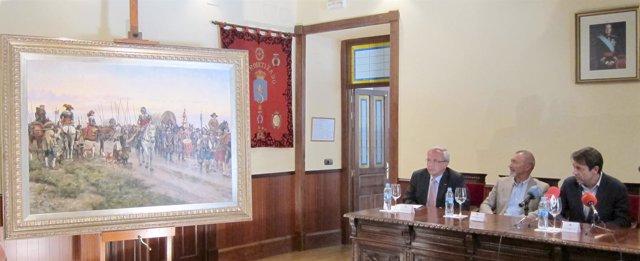 Pérez Reverte (centro) y Augusto Dalmau (derecha) presentan el cuadro
