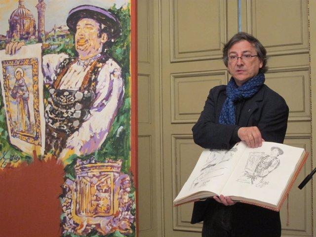 Miguel Elías delante de su cartel muestra bocetos previos a la obra definitiva