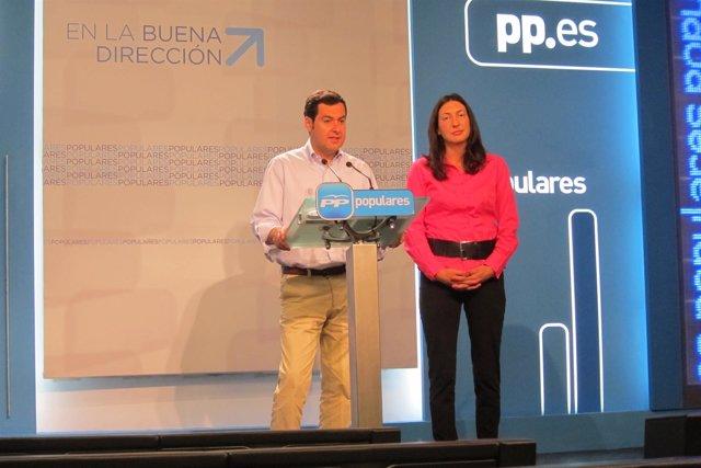 Juanma Moreno y Loles López en rueda de prensa en Génova