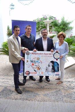 Palomares, Caballero, Madrid y Botella con el cartel de las olimpiadas