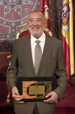 Juan Luis Guijarro con el premio