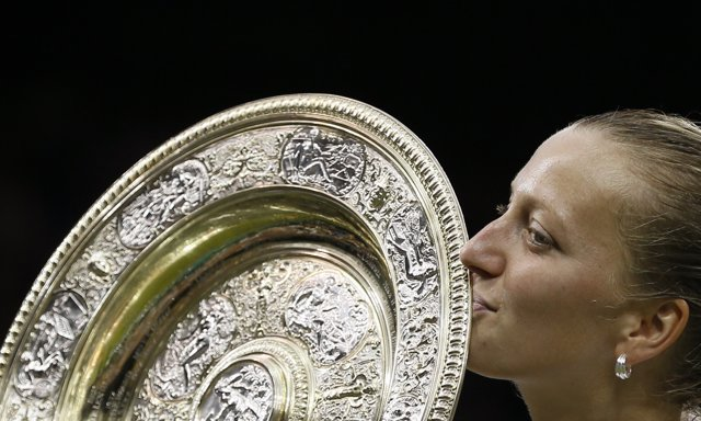 Petra Kvitova of Czech Republic kisses the winner's trophy, the Venus Rosewater
