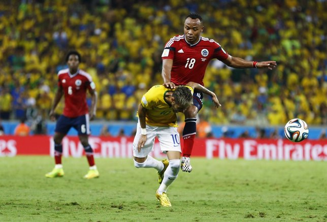 Brazil's Neymar is fouled by Colombia's Camilo Zuniga during 2014 World Cup quar