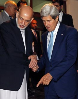 U.S. Secretary of State John Kerry and Afghanistan's President Hamid Karzai spea