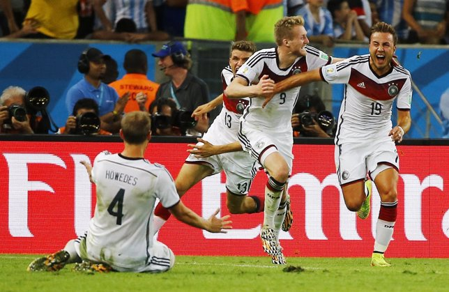 Germany's Goetze celebrates with his teammates after scoring against Argentina d
