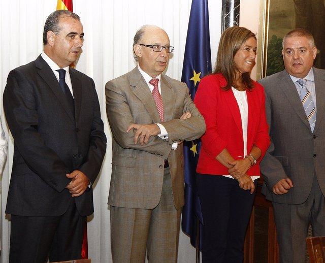 Luciano Poyato junto con los ministros Montoro y Mato