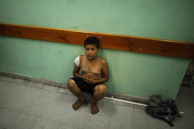 A Palestinian boy sits at a hospital in the northern Gaza Strip