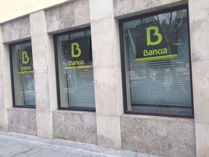 Economía/Finanzas.- (Ampl.) BFA-Bankia gana 827 millones en el primer semestre, un 93% más