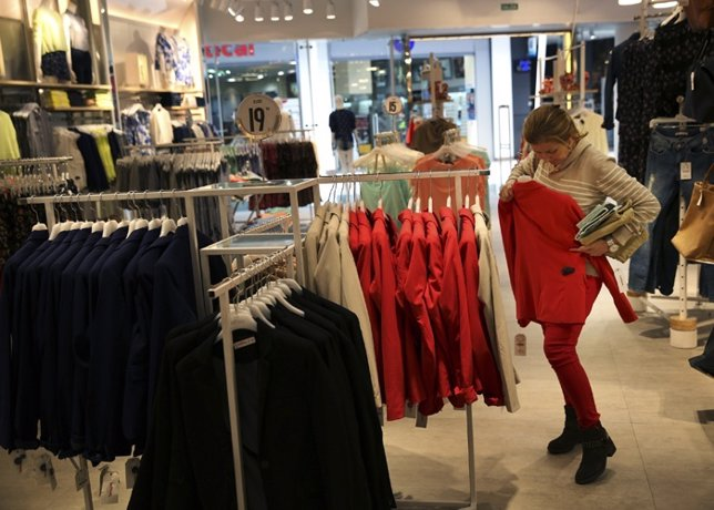 A woman shops at a Lefties store in Madrid March 14, 2014.  While Inditex's Zara