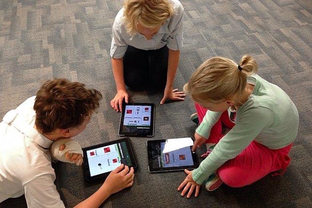 Niños con tablets