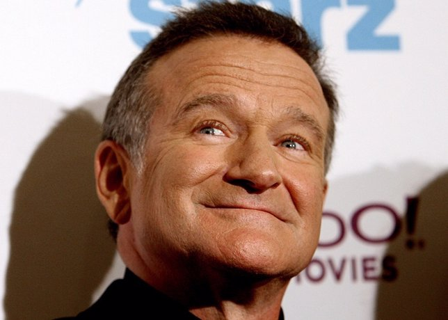 Actor Robin Williams poses at 10th annual