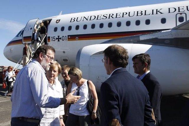 Rajoy recogiendo a Merkel