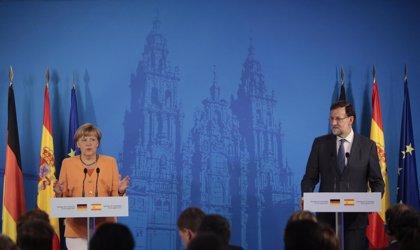 Merkel apoyará la candidatura de Luis de Guindos a presidir el Eurogrupo