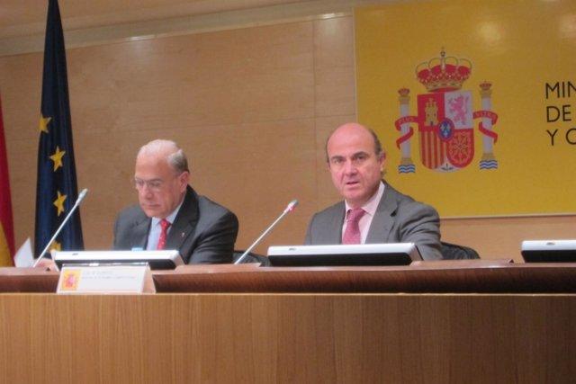 Luis de Guindos y Angel Gurría