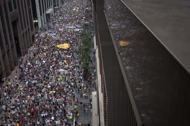 Tens of thousands march down 6th Avenue while taking part in the People's Climat