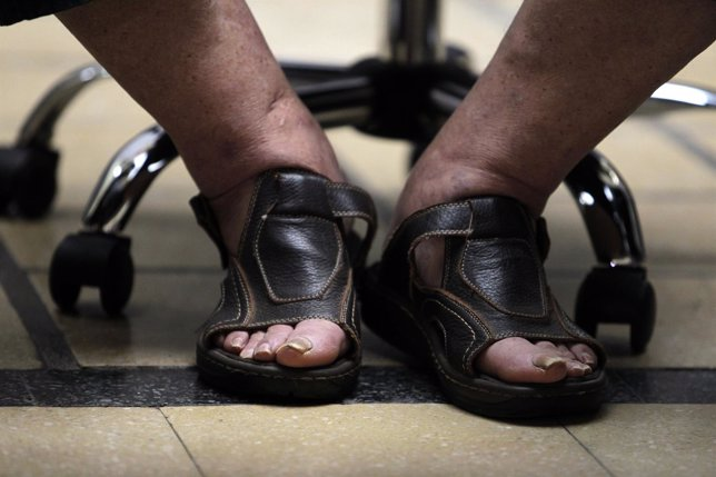 Sandals of Uruguay's President Jose Mujica seen as he participates in signing in
