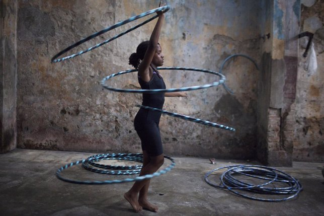 Girl performs with hoops during a training session at a circus school in Havana